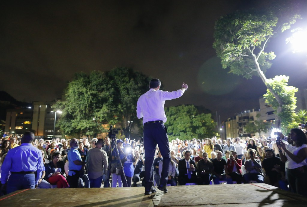 Venezuelan opposition leader and self-proclaimed interim president Juan Guaido speaks during a citizen's meeting in in Caracas, Venezuela, Wednesday, ...