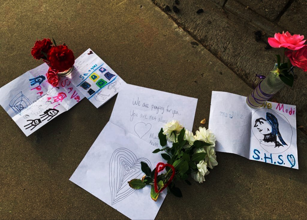 Flowers and notes have been left outside Saugus High School in Santa Clarita, Calif., late Thursday afternoon, Nov. 1, 2019, after a shooting incident...