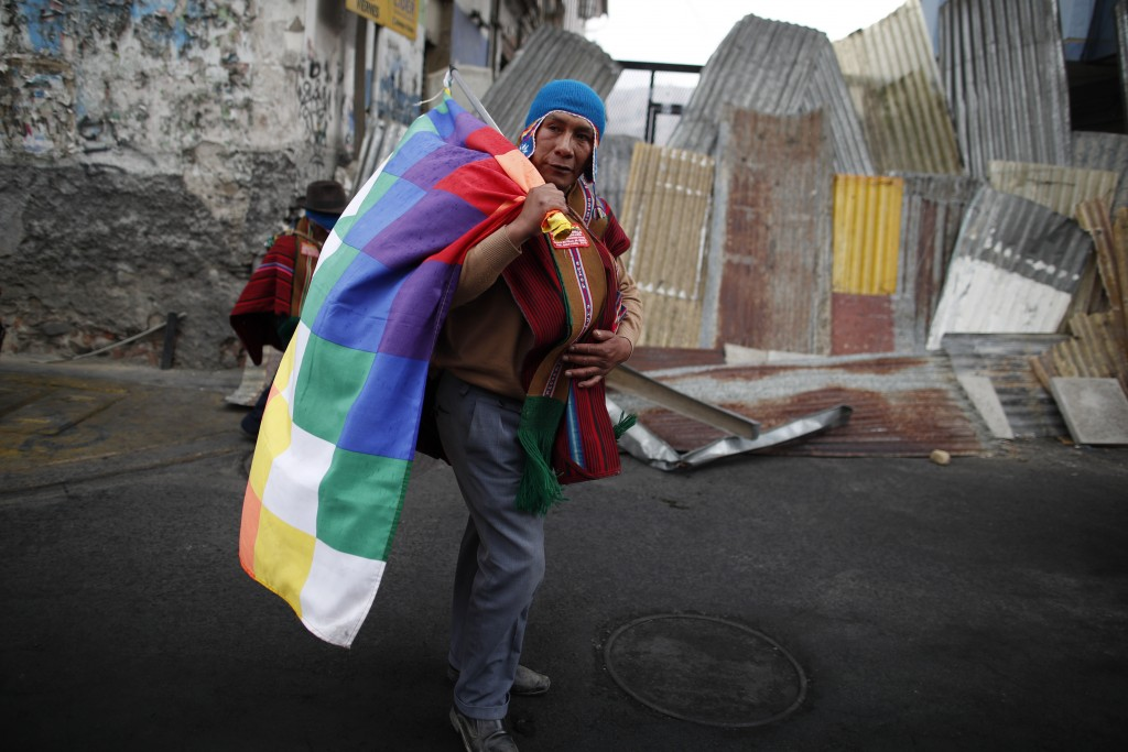 A supporter of former President Evo Morales marches in La Paz, Bolivia, Thursday, Nov. 14, 2019. Morales resigned and flew to Mexico under military pr...