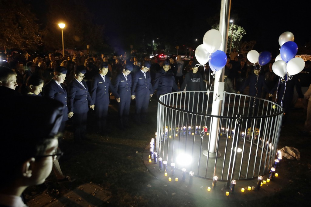Members of Saugus High School's Air Force JUNIOR ROTC unit hold a moment of silence in memory of the victims of a shooting at the school earlier in th...