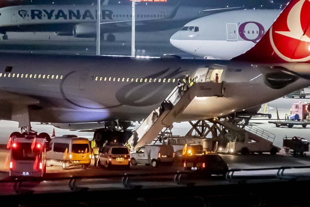 In this , Tursday, Nov. 14, 2019 photo people leave an airplaine of the airline 'Turkish Airline' at the airport Tegel in Berlin, Germany. German fede...