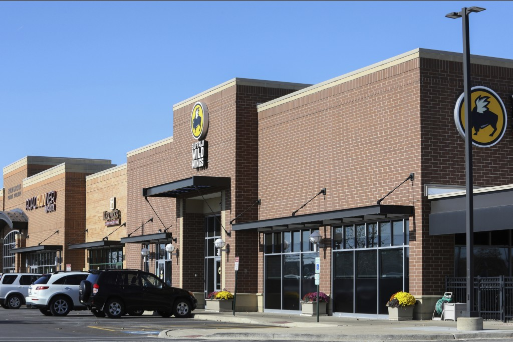 FILE - This Nov. 5, 2019, file photo shows the Buffalo Wild Wings restaurant in Naperville, Ill., a suburb of Chicago. Police investigating an inciden...
