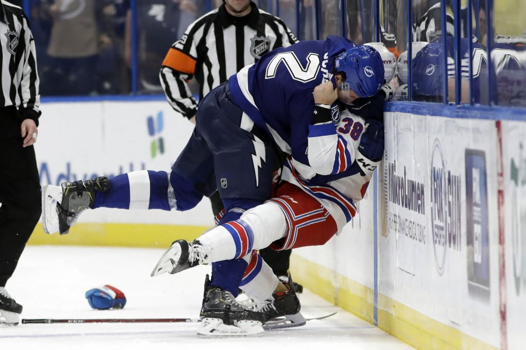 Tampa Bay Lightning defenseman Luke Schenn (2) slams New York Rangers center Micheal Haley (38) into the boards as they fight during the second period...