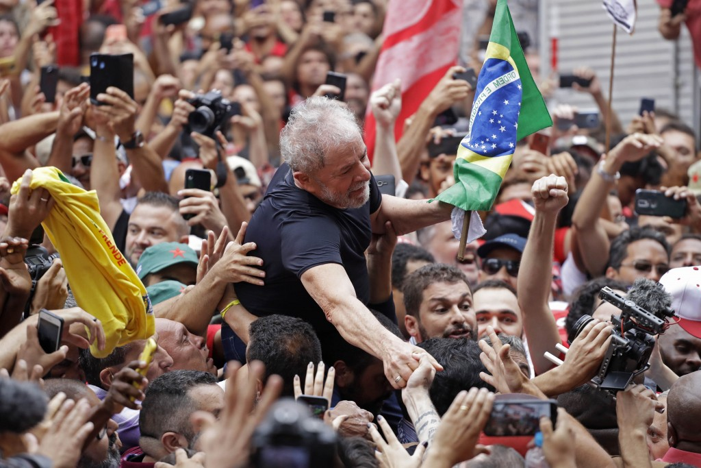 In this Saturday, Nov. 9, 2019 photo, former Brazilian President Luiz Inacio Lula da Silva is carried by supporters during a rally at the Metal Worker...