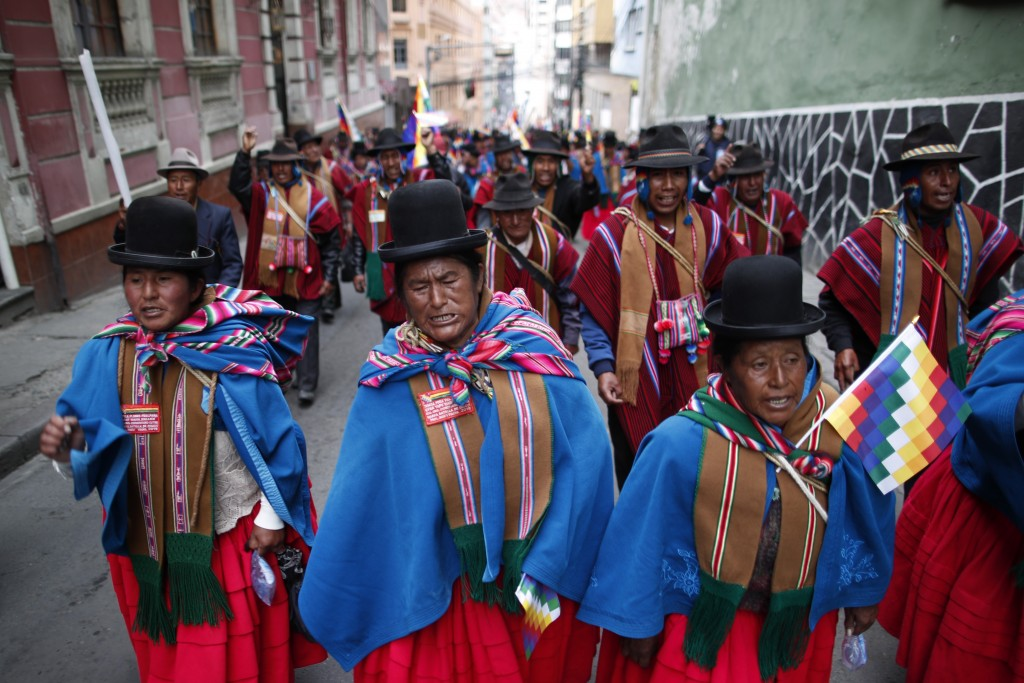 Supporters of former President Evo Morales march in La Paz, Bolivia, Thursday, Nov. 14, 2019. Morales resigned and flew to Mexico under military press...