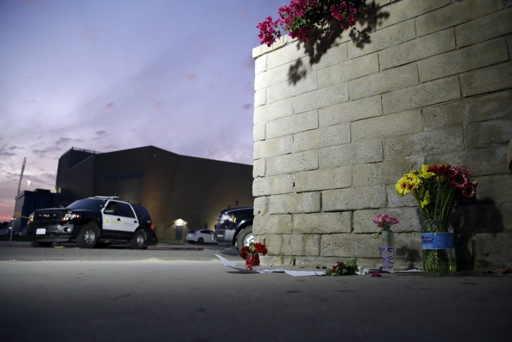 Flowers are placed in front of Saugus High School in the aftermath of a shooting on Thursday, Nov. 14, 2019, in Santa Clarita, Calif. (AP Photo/Marcio...