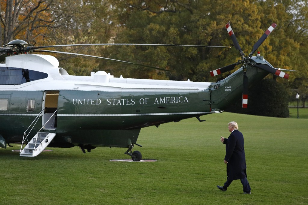 President Donald Trump walks to Marine One on the South Lawn of the White House in Washington, Thursday, Nov. 14, 2019, for a short trip to Andrews Ai...