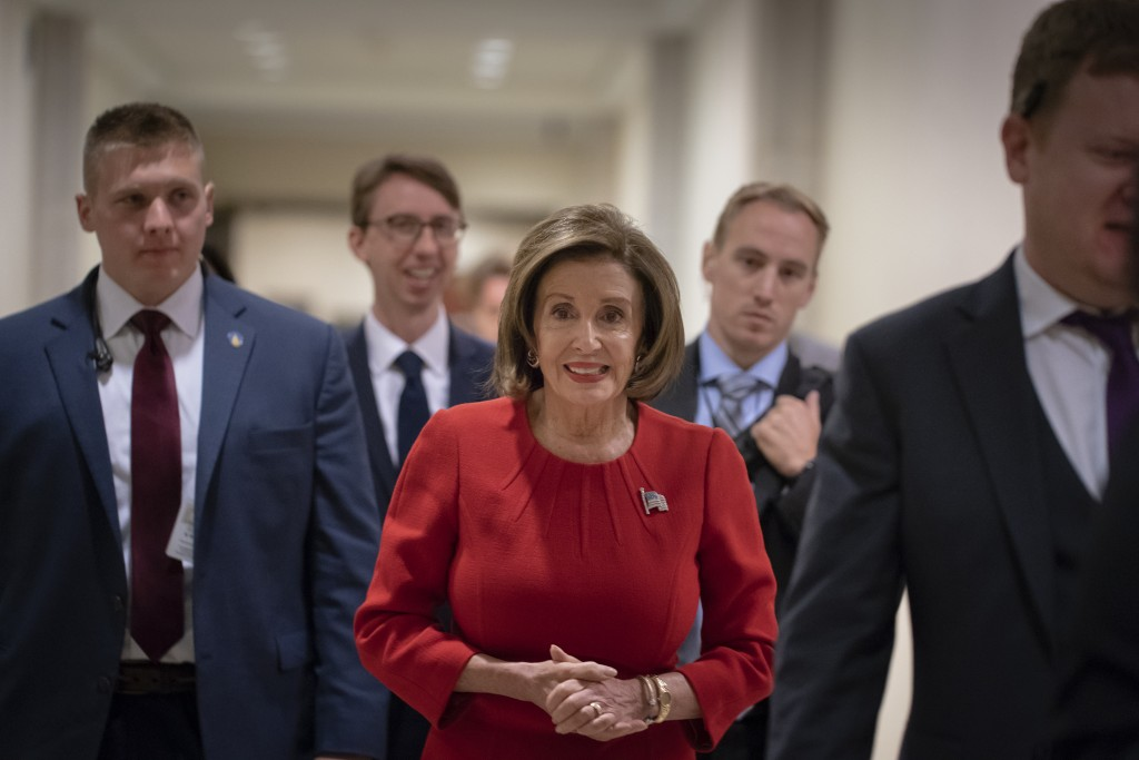 Speaker of the House Nancy Pelosi, D-Calif., arrives to talk to reporters on the morning after the first public hearing in the impeachment probe of Pr...
