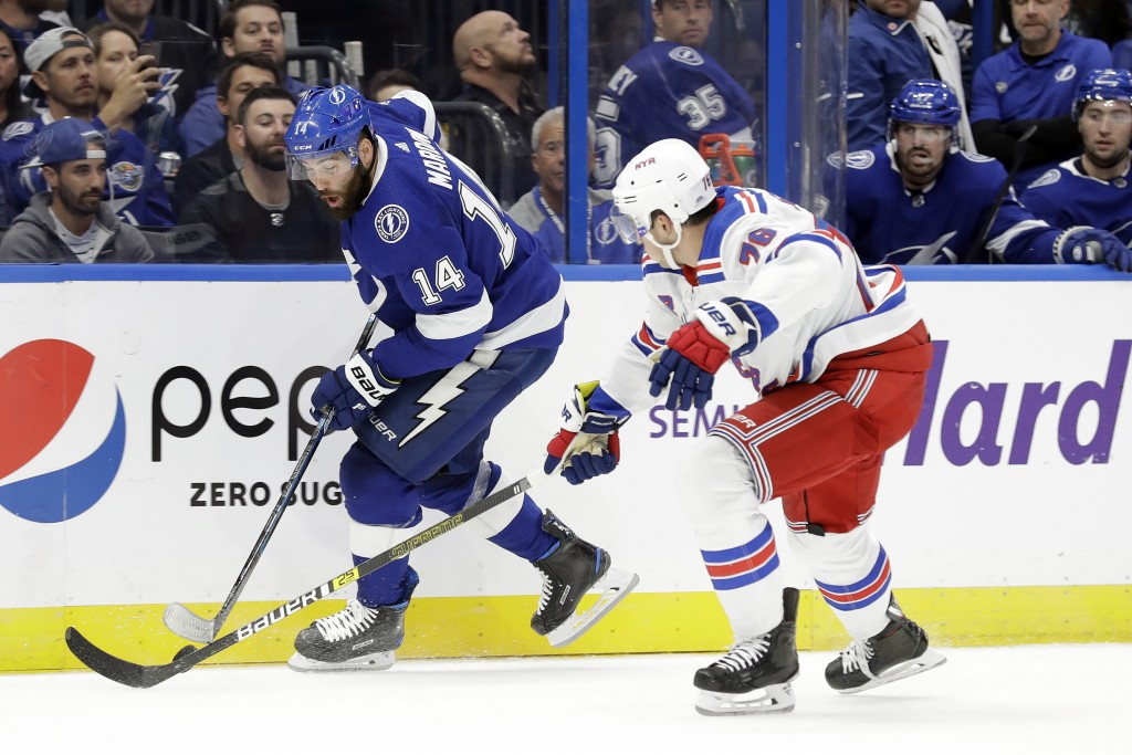 Tampa Bay Lightning left wing Pat Maroon (14) tries to get around New York Rangers defenseman Brady Skjei (76) during the second period of an NHL hock...