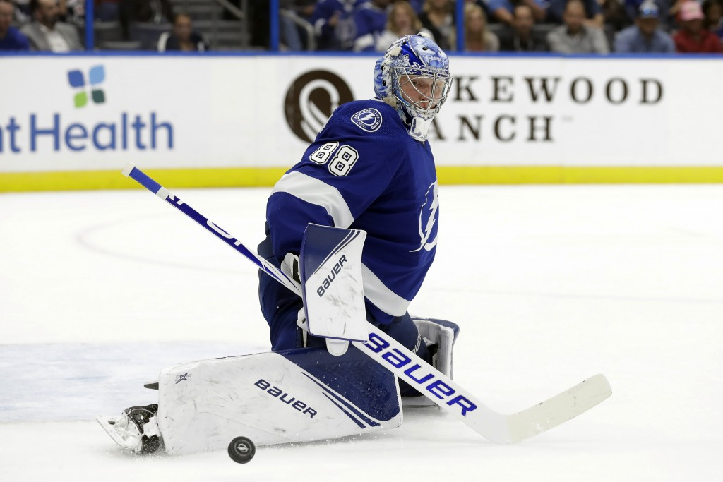 Tampa Bay Lightning goaltender Andrei Vasilevskiy makes a save on a shot by the New York Rangers during the first period of an NHL hockey game Thursda...