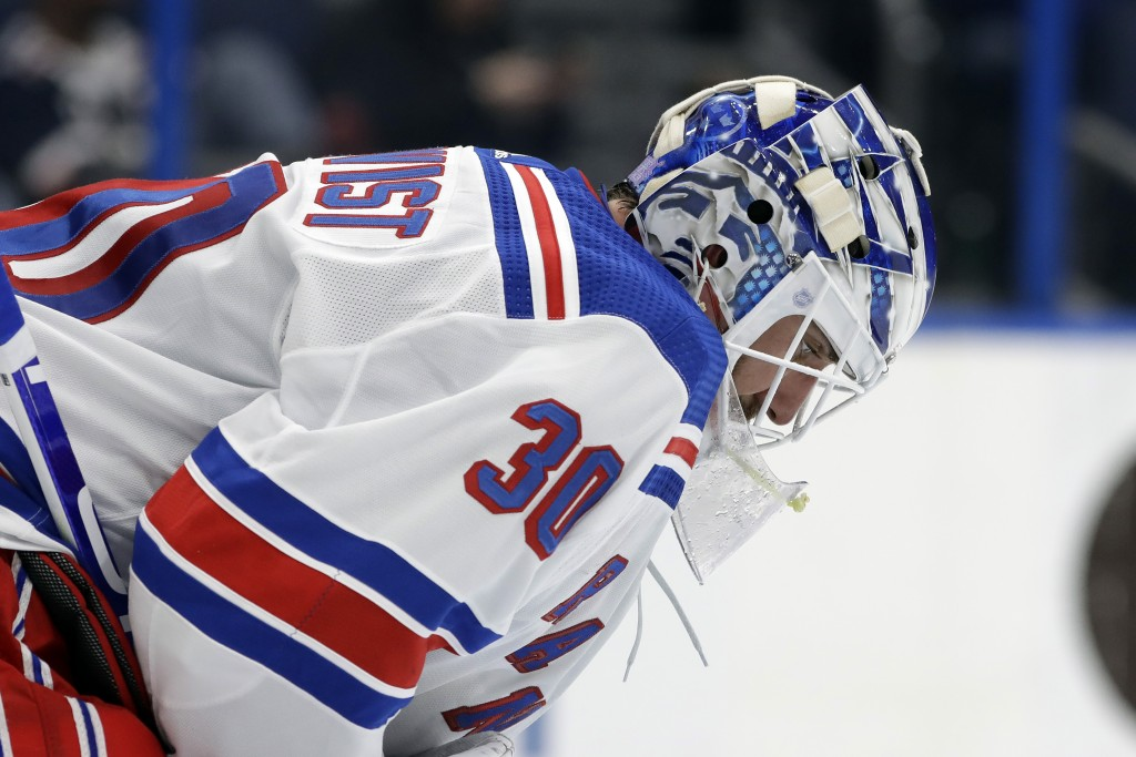 New York Rangers goaltender Henrik Lundqvist reacts after giving up a goal to the Tampa Bay Lightning during the second period of an NHL hockey game T...