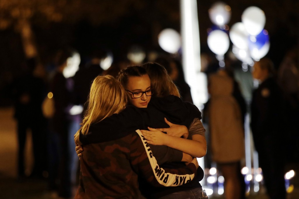 Students embrace during a vigil at Central Park in the aftermath of a shooting at Saugus High School Thursday, Nov. 14, 2019, in Santa Clarita, Calif....