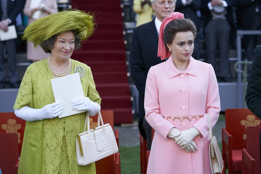 In this image released by Netflix, Marion Bailey portrays Queen Elizabeth the Queen Mother, left, and Helena Bonham Carter portrays Princess Margaret ...