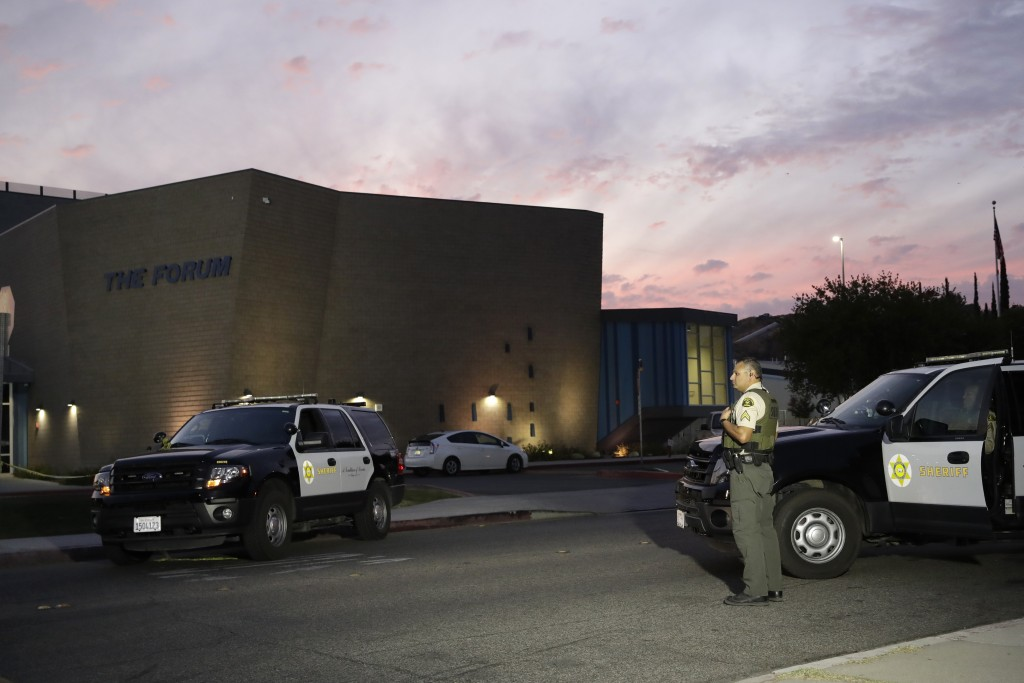 A member of the Los Angeles County Sheriff Department outside of Saugus High School in the aftermath of a shooting on Thursday, Nov. 14, 2019, in Sant...
