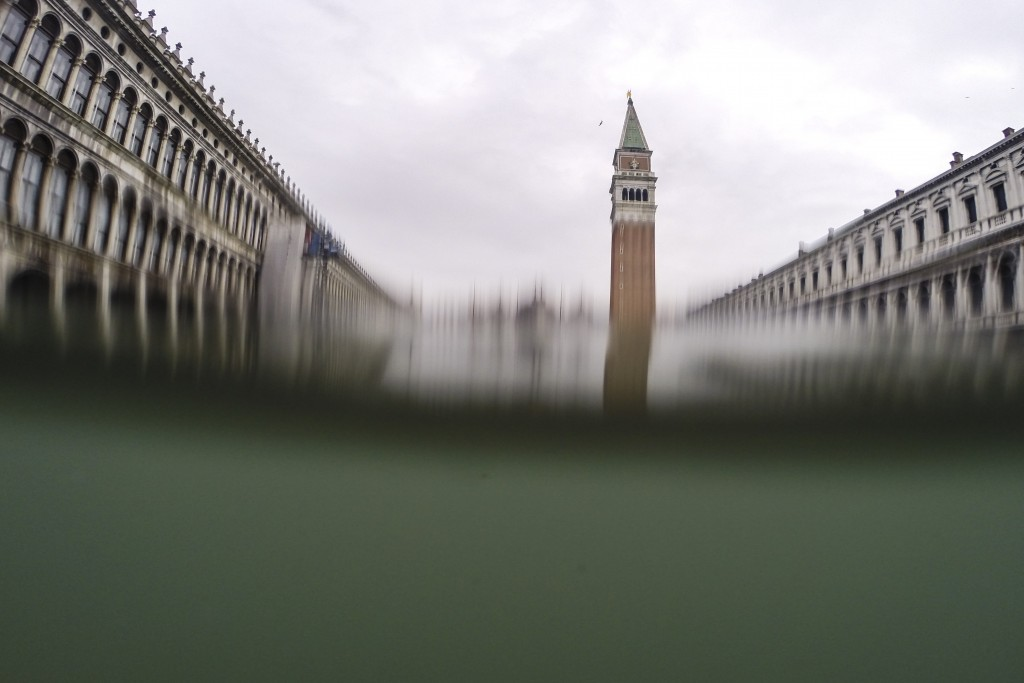 Flooded St. Mark's Square is seen from a partially submerged camera, in Venice, Italy, Friday, Nov. 15, 2019. Waters are rising in Venice where the ti...