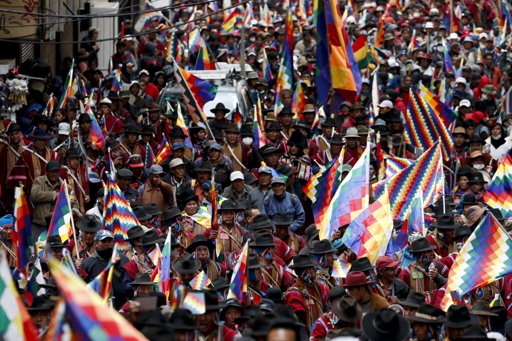 Backers of former President Evo Morales march in La Paz, Bolivia, Thursday, Nov. 14, 2019. Morales resigned and flew to Mexico under military pressure...