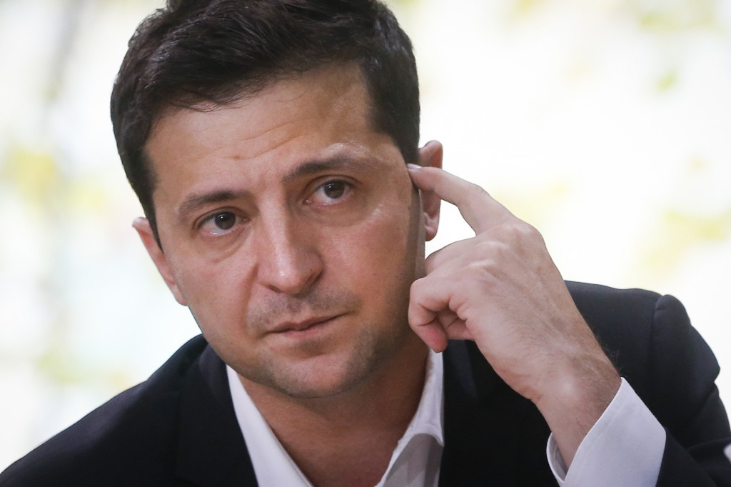 FILE In this file photo taken on Thursday, Oct. 10, 2019, Ukrainian President Volodymyr Zelenskiy attends his long time talks with journalists in Kyiv...