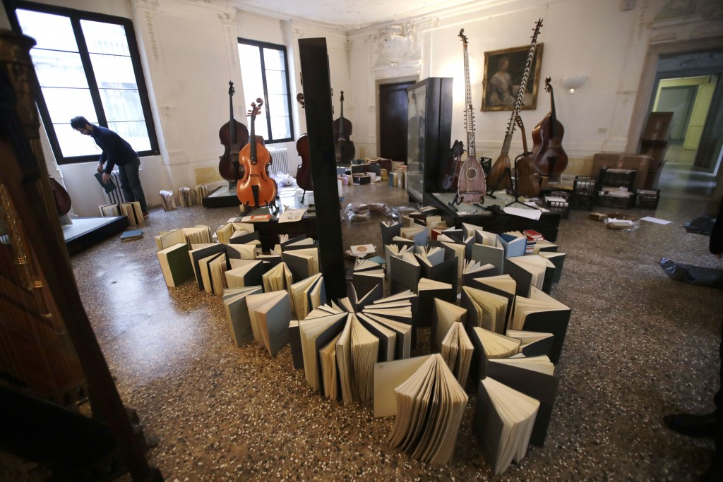 Volunteers try to save ancient music books by placing them to dry at the first floor of Venice Conservatory after recovering them from ground floor, I...