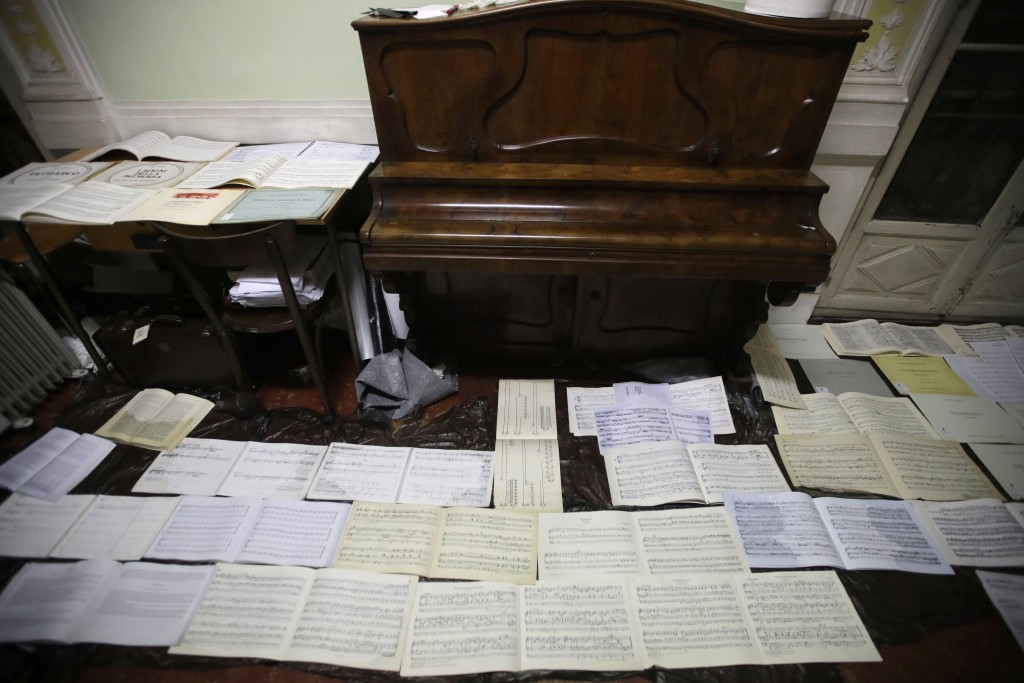 Ancient music sheets are placed to dry at the first floor of Venice Conservatory after being recovered from ground floor, Italy, Saturday, Nov. 16, 20...