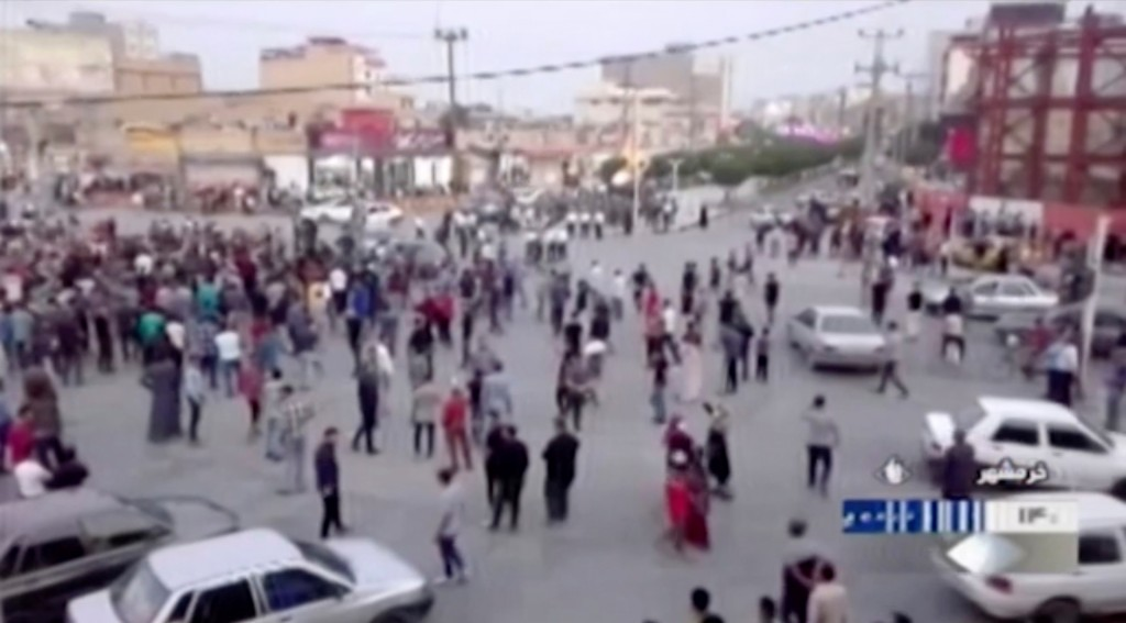In this Saturday, Nov. 16, 2019 image from video aired by Iran's Islamic Republic of Iran Broadcasting state television channel, protesters gather on ...