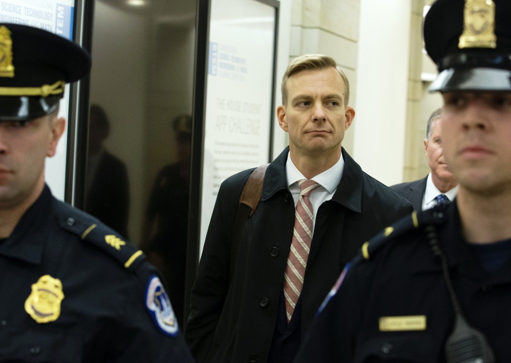 David Holmes, the political counsel at the U.S. Embassy in Ukraine, leaves the Capitol Hill, Friday, Nov. 15, 2019, in Washington, after he testified ...