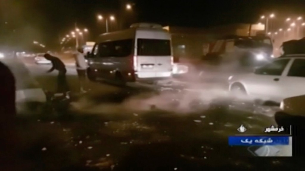 In this Saturday, Nov. 16, 2019 image from video aired by Iran's Islamic Republic of Iran Broadcasting state television channel, protesters are seen o...