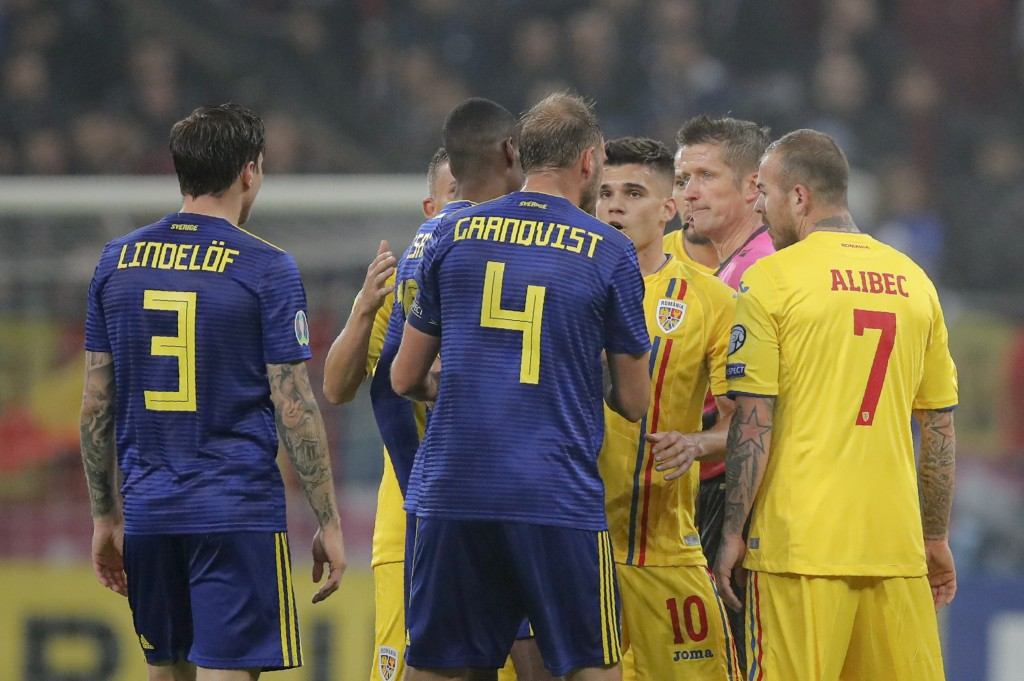 Referee Daniele Orsato, second from right, stops the game following alleged racist chants against Sweden's Alexander Isak during the Euro 2020 group F...