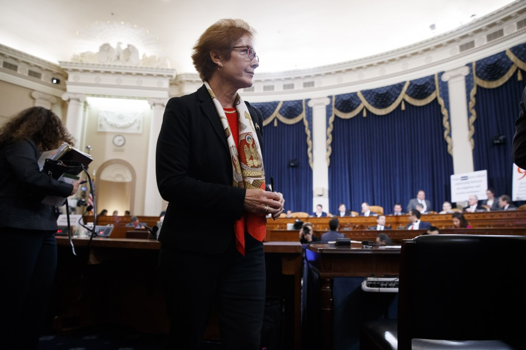 Former U.S. Ambassador to Ukraine Marie Yovanovitch gets up during a break in testimony before the House Intelligence Committee, Friday, Nov. 15, 2019...