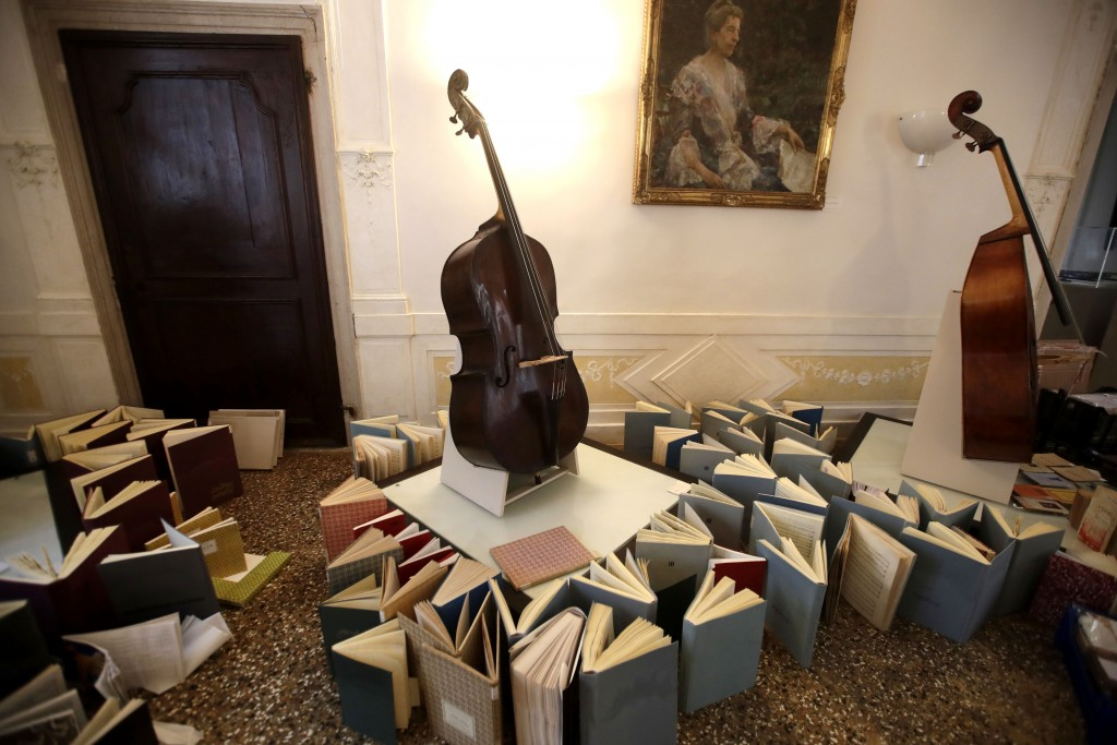 Music books are placed to dry at the first floor of Venice Conservatory after being recovered from ground floor, Italy, Saturday, Nov. 16, 2019. High ...