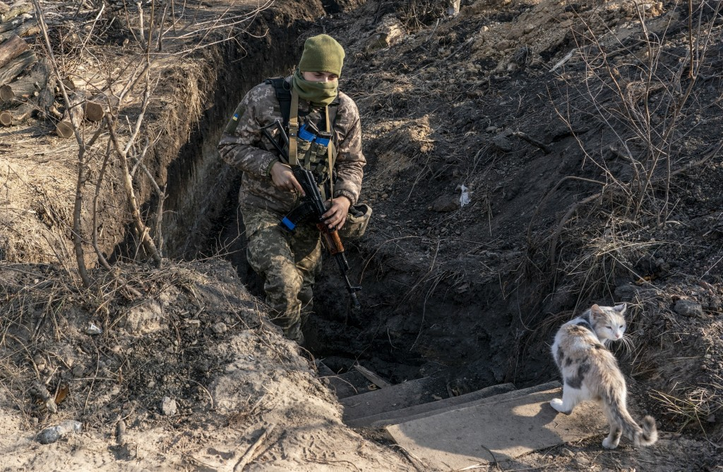 FILE-  In this Nov. 2, 2019, file photo, a Ukrainian serviceman walks up from a trench at the new line of contact in Zolote, Luhansk region, eastern U...