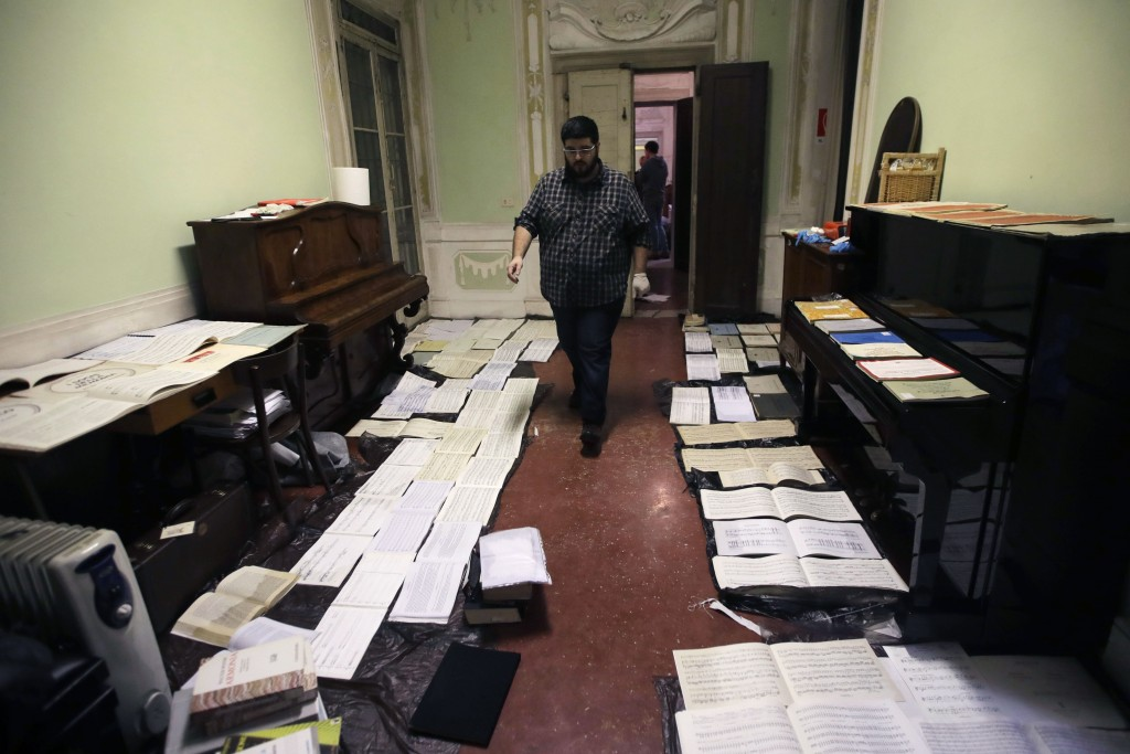 Volunteers try to save ancient music sheets by placing them to dry at the first floor of Venice Conservatory after recovering them from ground floor, ...