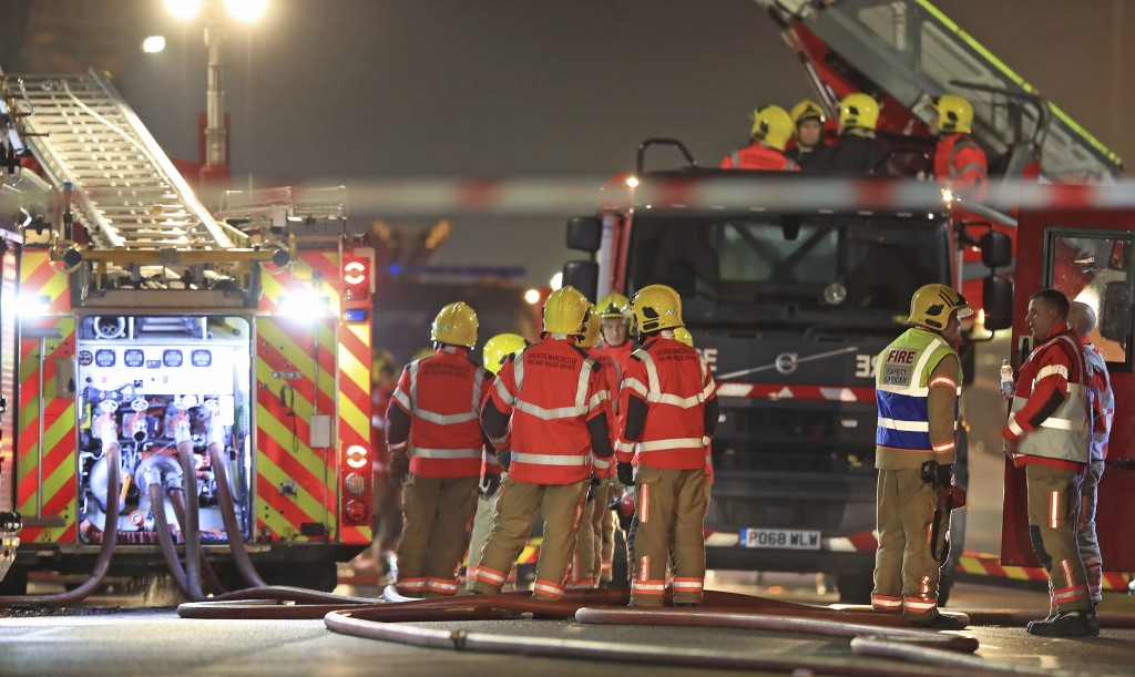 Fire fighters at the scene of a major fire at a student residential building in Bolton, England, late Friday Nov. 15, 2019.  Fire crews tackled the la...