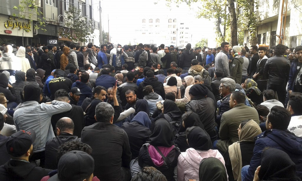 Protestors attend a demonstration after authorities raised gasoline prices, in the northern city of Sari, Iran, Saturday, Nov. 16, 2019. Protesters an...