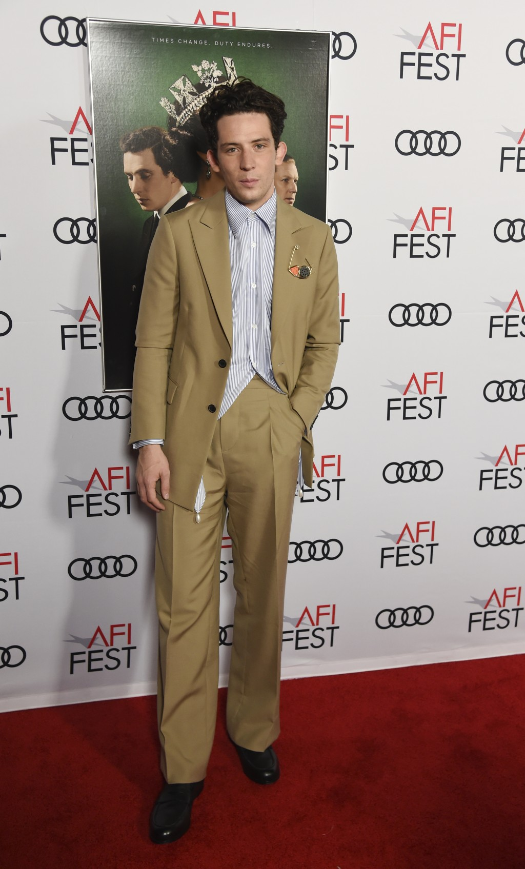 """Josh O'Connor, a cast member in the Netflix series """"The Crown,"""" poses at a gala screening of the show at the 2019 AFI Fest at the TCL Chinese Theatre,..."""