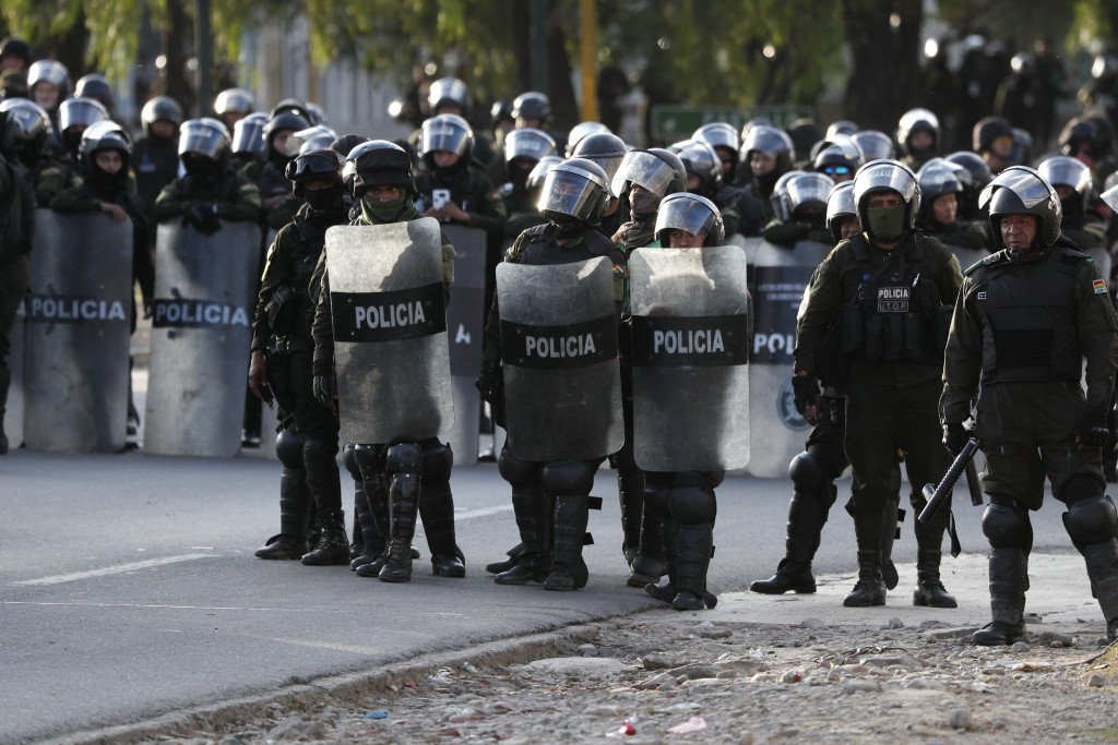 Police block coca leaf producers, backers of former President Evo Morales, from continuing their march to Cochabamba, Bolivia, Saturday, Nov. 16, 2019...