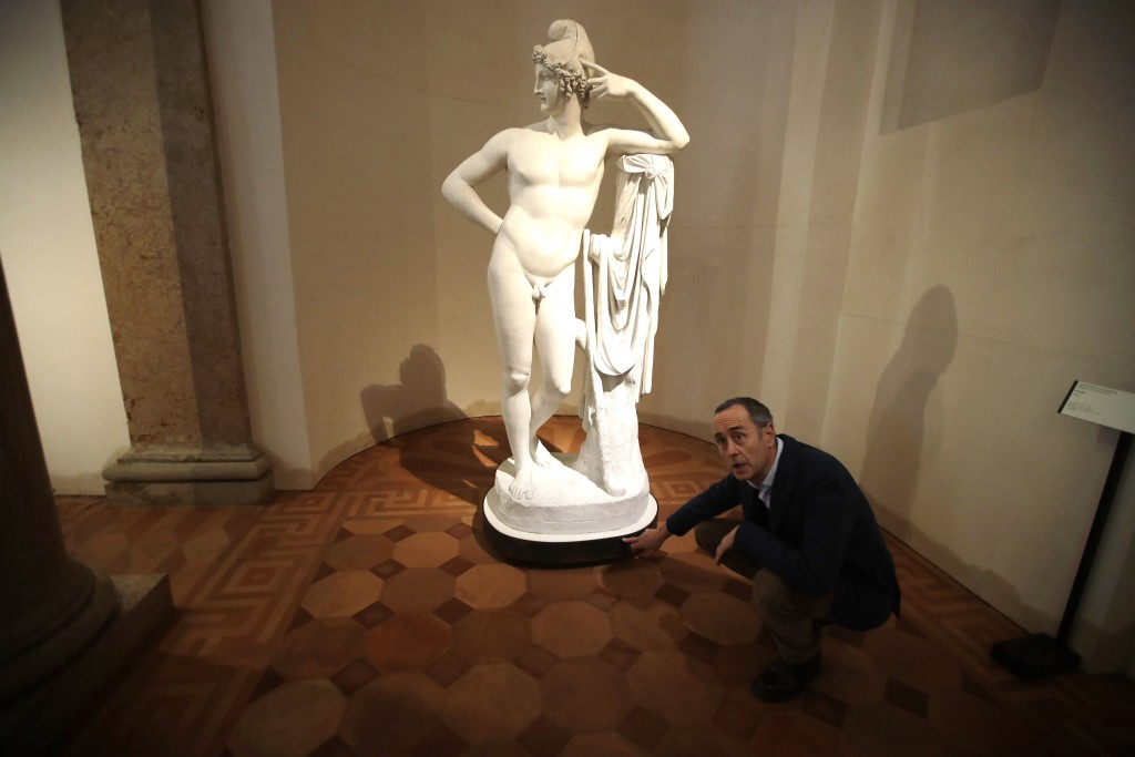 Giulio Manieri Elia, Director of the Accademia Gallery points the level reached by the water at the base of plaster cast sculpture 'Paride' by Antonio...
