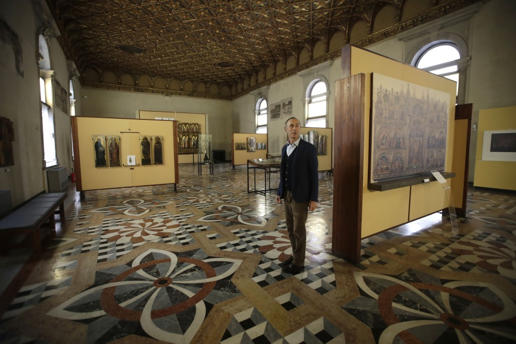 Giulio Manieri Elia, Director of the Accademia Gallery stands in one of the rooms of the gallery during an interview with the Associated Press, in Ven...