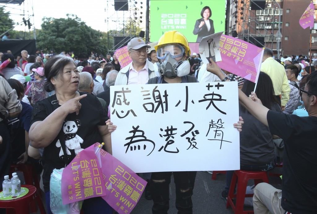 """A hong Kong supporter of Taiwan President and Democratic Progressive Party presidential candidate Tsai Ing-wen, holds a slogan reading """"Thanks to Pres..."""
