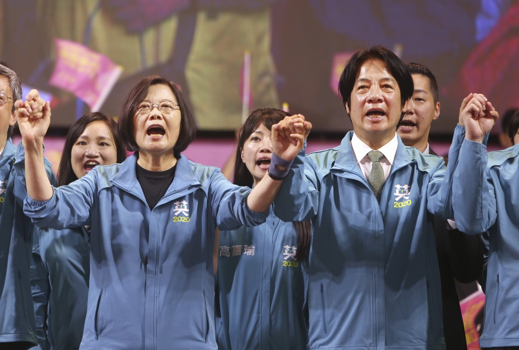 Taiwan President and Democratic Progressive Party presidential candidate Tsai Ing-wen, left, and her running mate William Lai cheer as Tsai launches h...