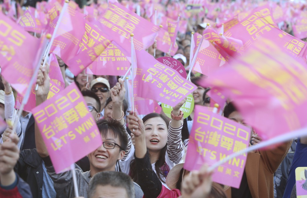 Supporters of Taiwan President and Democratic Progressive Party presidential candidate Tsai Ing-wen cheer as Tsai launches her re-election campaign in...