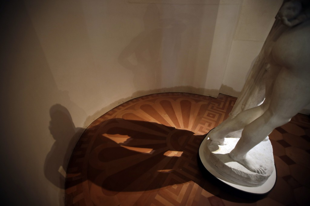 A wet mark at the base of the wall shows the level the water reached next to the base of the plaster cast sculpture 'Paride' by Antonio Canova, at the...