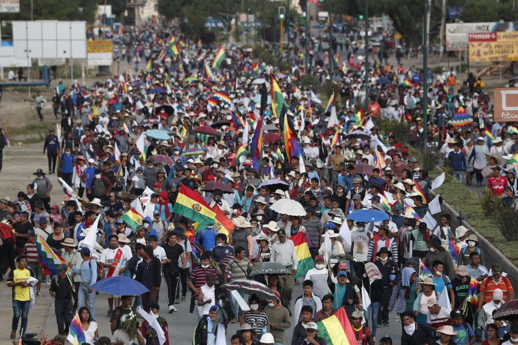 Coca leaf producers, supporters of former President Evo Morales march to Cochabamba from Sacaba, Bolivia, Saturday, Nov. 16, 2019.  Officials now say ...