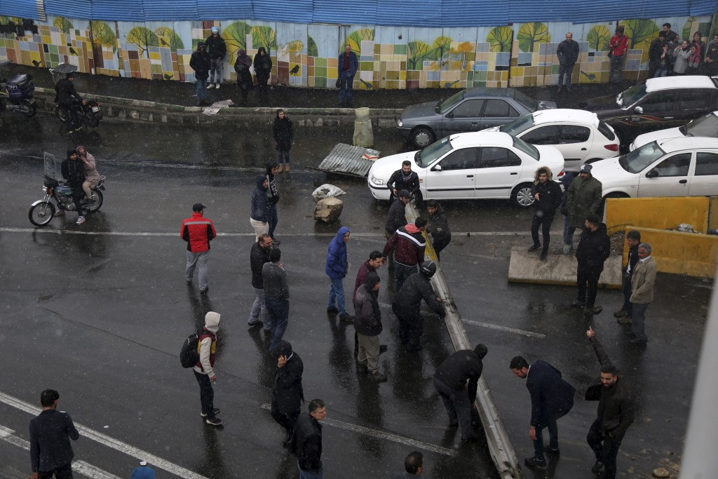 Protestors block a road after authorities raised gasoline prices, in Tehran, Iran, Saturday, Nov. 16, 2019. Protesters angered by Iran raising governm...