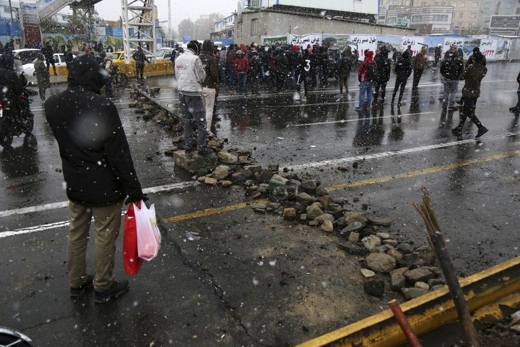 A road is blocked by protestors after authorities raised gasoline prices, in Tehran, Iran, Saturday, Nov. 16, 2019. Protesters angered by Iran raising...