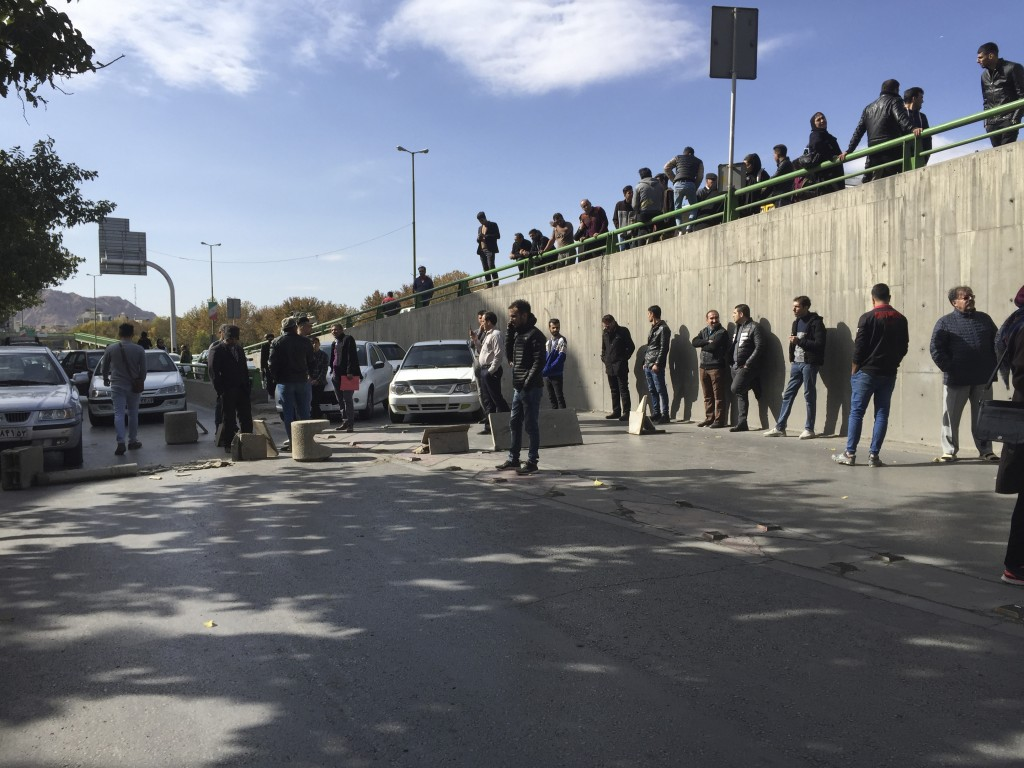 Demonstrators block a street during a protest after authorities raised gasoline prices, in the central city of Isfahan, Iran, Saturday, Nov. 16, 2019....