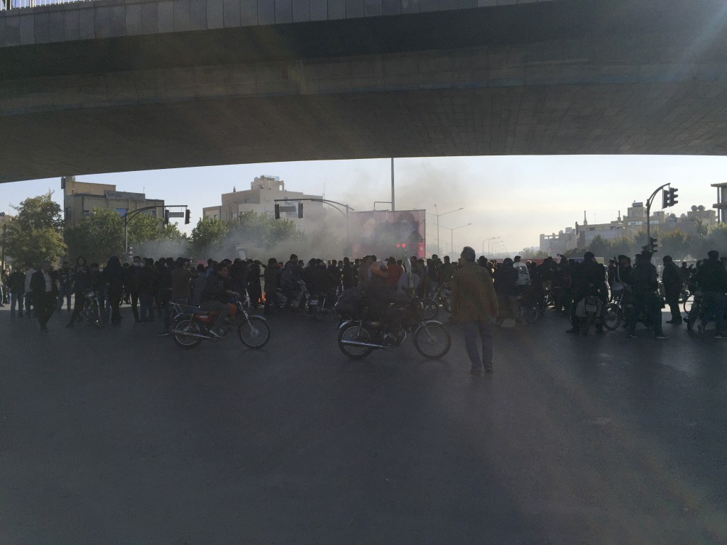 Streets are blocked in a protest after authorities raised gasoline prices, in the central city of Isfahan, Iran, Saturday, Nov. 16, 2019. Protesters a...