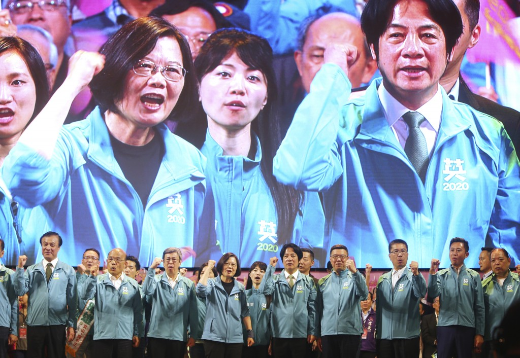 Taiwan President and Democratic Progressive Party presidential candidate Tsai Ing-wen, front fourth from left, and her running mate William Lai, fifth...