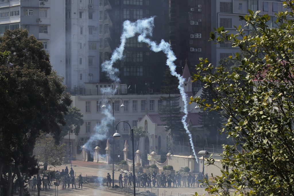 Police fire tear gas at Hong Kong Polytechnic University in Hong Kong, Sunday, Nov. 17, 2019. Police fired tear gas at protesters holding out at Hong ...