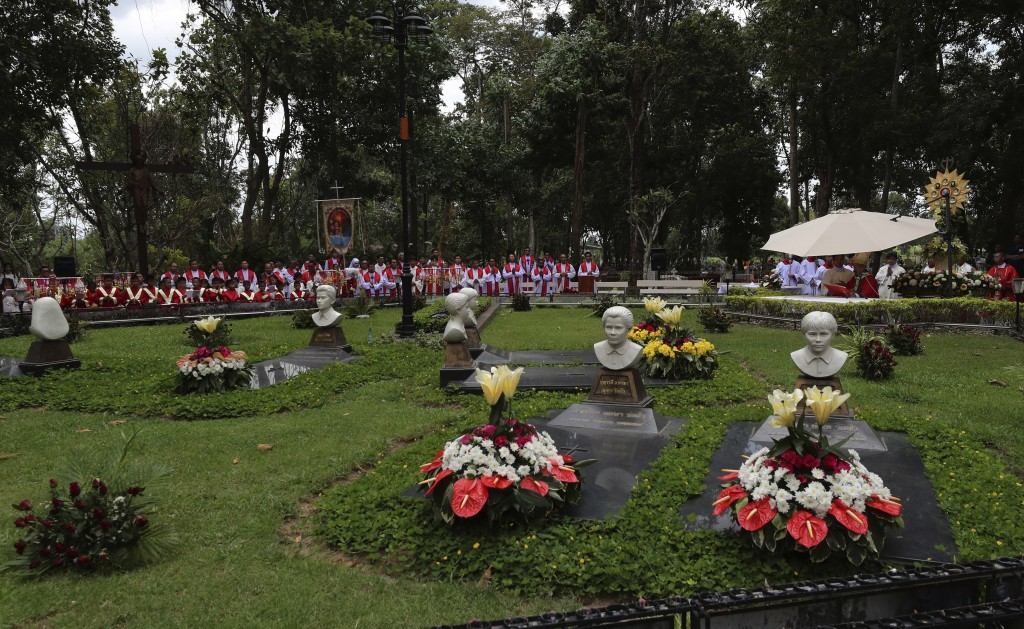 In this Saturday, Oct.19, 2019, Catholic pray at seven martyrs cemetery during 30th anniversary of the beatification of seven martyrs at Songkhon vill...