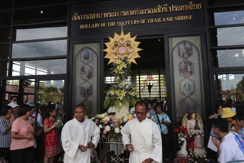 In this Saturday, Oct. 19, 2019, photo, Catholic devotees pulling a pedestal with images of the seven martyrs at Christ Church, Songkhon village, Mukd...